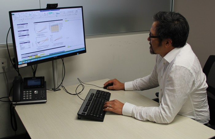 Jason Leung-Wai studying graphs on a computer